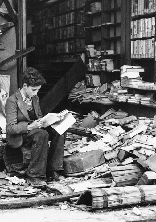boy reading, london, 1944, after a bombing